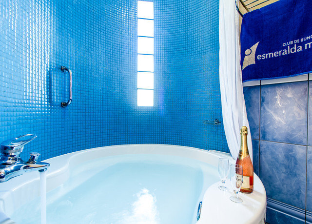 bathroom blue swimming pool sink toilet plumbing fixture bathtub tub tiled tile Bath