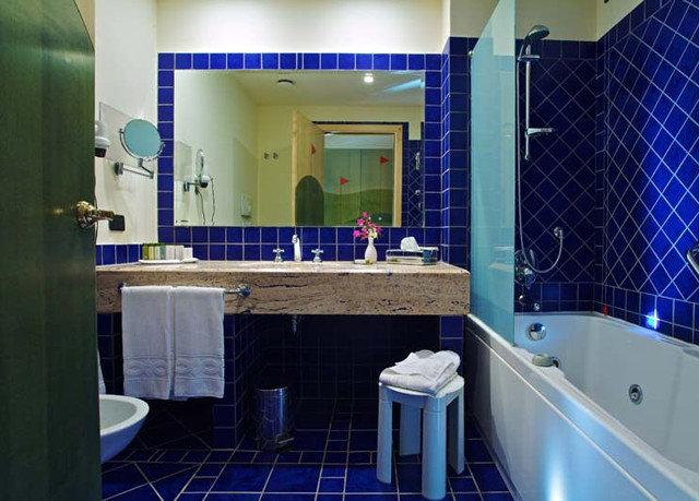 bathroom swimming pool sink plumbing fixture tub public toilet bathtub toilet blue tile tiled Bath