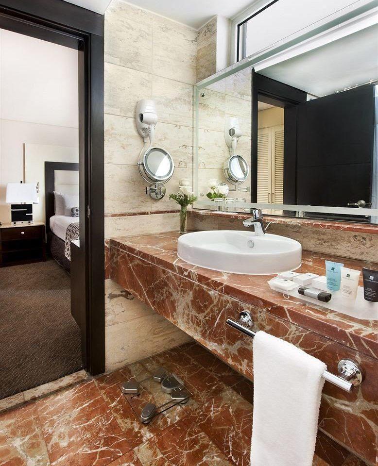 bathroom property countertop sink flooring tile hardwood cuisine classique home wood flooring laminate flooring material living room cabinetry tub Bath bathtub tiled