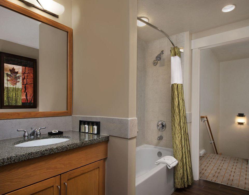 bathroom property mirror sink home cottage cabinetry flooring tub Bath bathtub