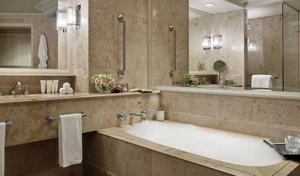 bathroom sink property mirror plumbing fixture home countertop bathtub tile flooring cabinetry Bath