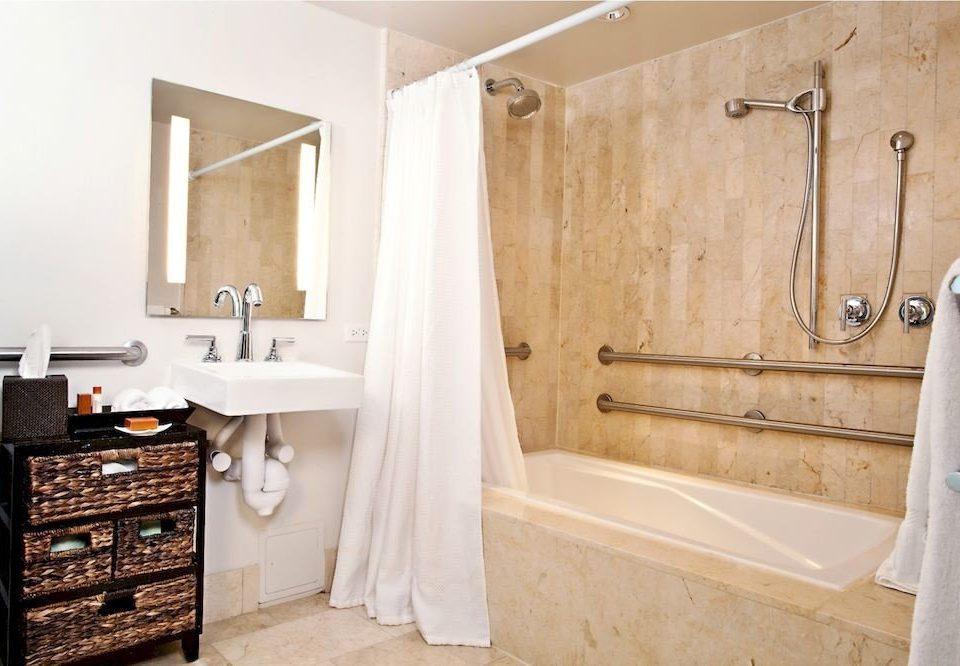 bathroom property scene hardwood home cottage cabinetry flooring tub Bath bathtub