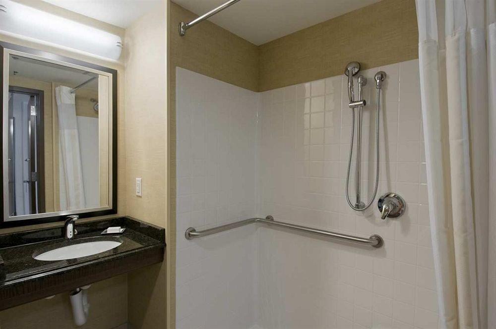 bathroom property sink scene toilet home shower cottage plumbing fixture rack Bath tub clean bathtub tile