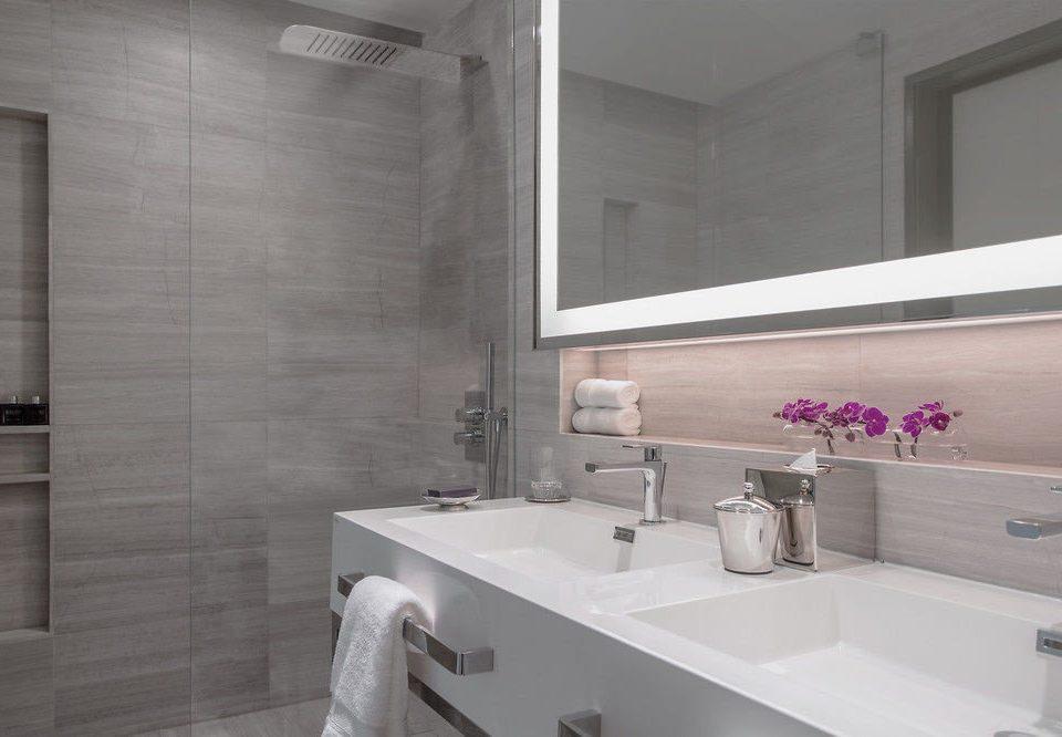 bathroom sink mirror property tile flooring countertop plumbing fixture tub clean Bath bathtub