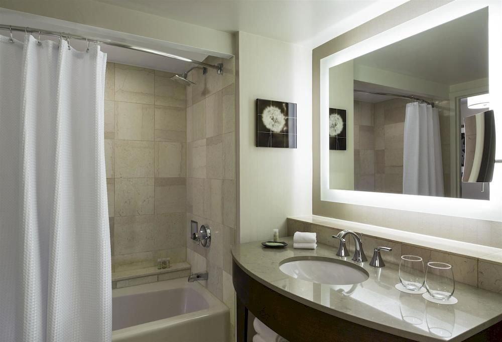 bathroom mirror sink property curtain shower home white plumbing fixture toilet tub clean tile bathtub Bath