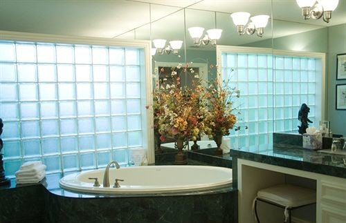 bathroom property sink home condominium flooring tub toilet tile bathtub Bath tiled