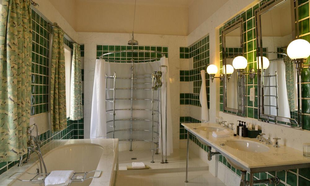 bathroom sink property condominium home tub bathtub mansion tile toilet tiled Bath