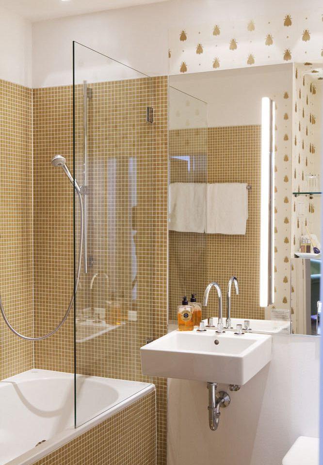 bathroom sink mirror plumbing fixture flooring tile bathtub toilet tiled Bath containing