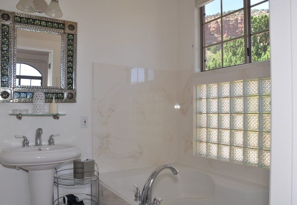 bathroom sink property mirror white home cottage tile toilet tub Bath bathtub tiled water basin