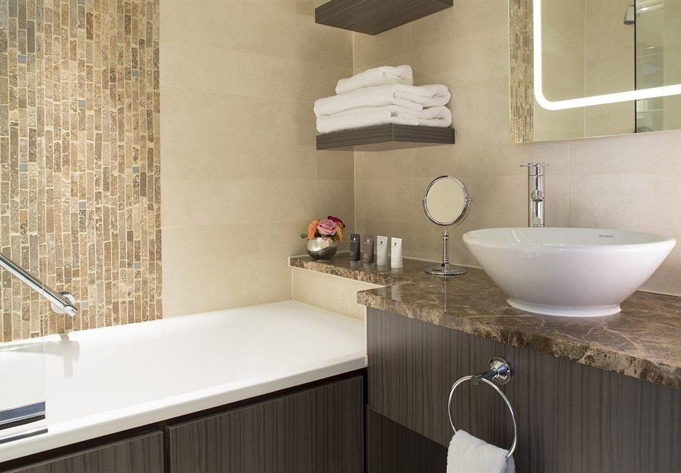 bathroom sink property vessel home counter flooring plumbing fixture cottage tub Bath tiled rack tile bathtub