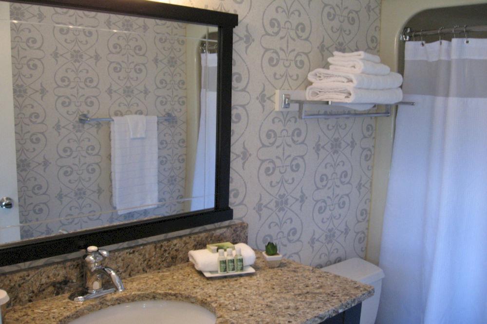 bathroom sink property home cottage curtain plumbing fixture tub Bath bathtub
