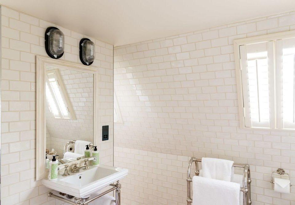 bathroom property sink cottage home farmhouse tile tiled Bath tub bathtub painted
