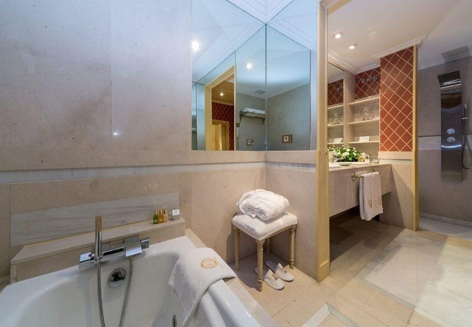 bathroom property sink toilet home cottage tub Bath bathtub tile tiled