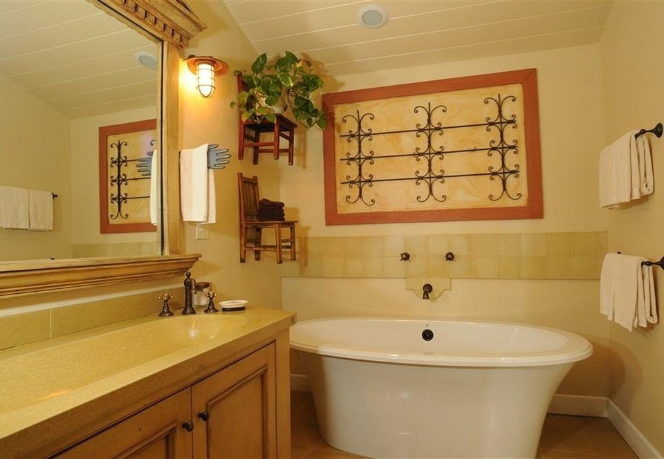 bathroom mirror property sink home cottage tub Bath rack bathtub