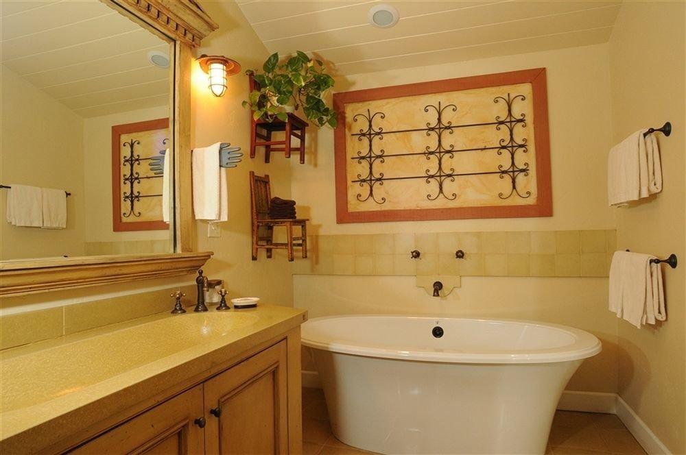 bathroom mirror property sink home cottage tub Bath rack bathtub
