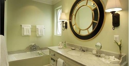 bathroom sink mirror property white home toilet cottage towel tile tub bathtub Bath