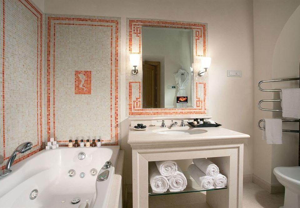 bathroom sink mirror property home cottage vessel toilet Bath tub bathtub