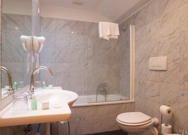 bathroom sink mirror property toilet plumbing fixture cottage flooring tub bathtub Bath