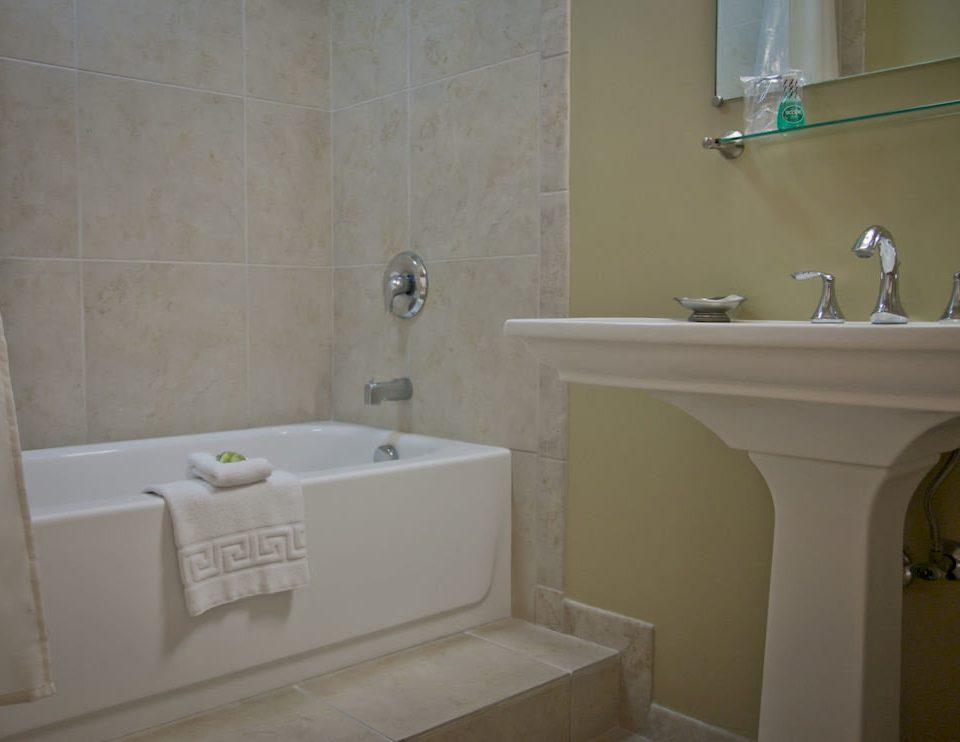 bathroom mirror property sink home plumbing fixture bathtub vessel cottage toilet tub Bath tile