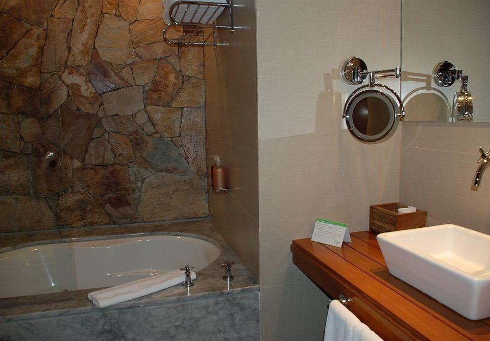 bathroom property tub sink plumbing fixture home cottage bathtub Bath