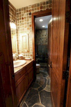 bathroom property house home hardwood cottage sink hall mansion tile tub tiled bathtub Bath