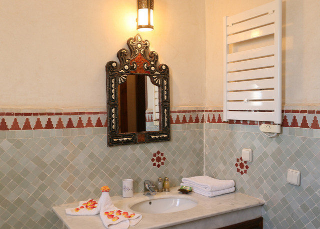 bathroom property sink home cottage tub Bath bathtub tiled tile