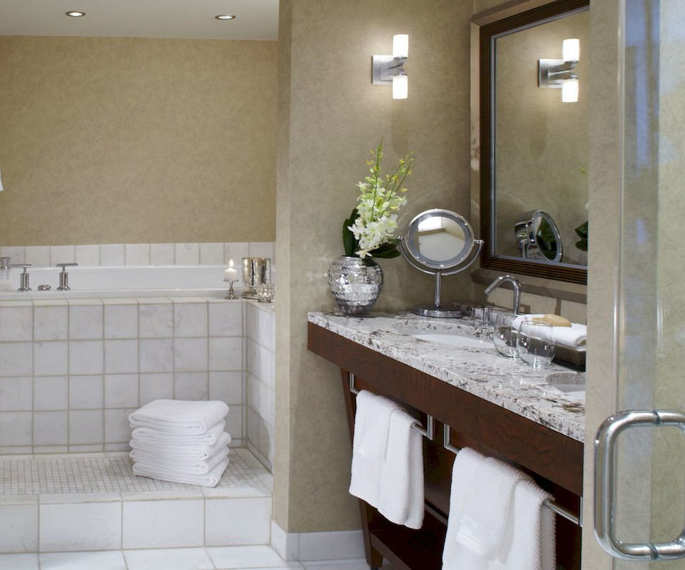 bathroom property mirror sink home towel plumbing fixture cottage tile flooring countertop rack tub Bath tiled bathtub
