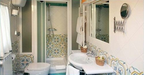 bathroom property sink home white cottage toilet tub Bath bathtub tiled