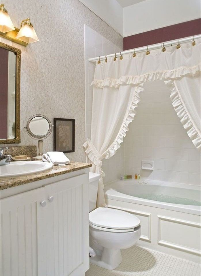 bathroom property toilet sink cottage tub Bath bathtub tile tan