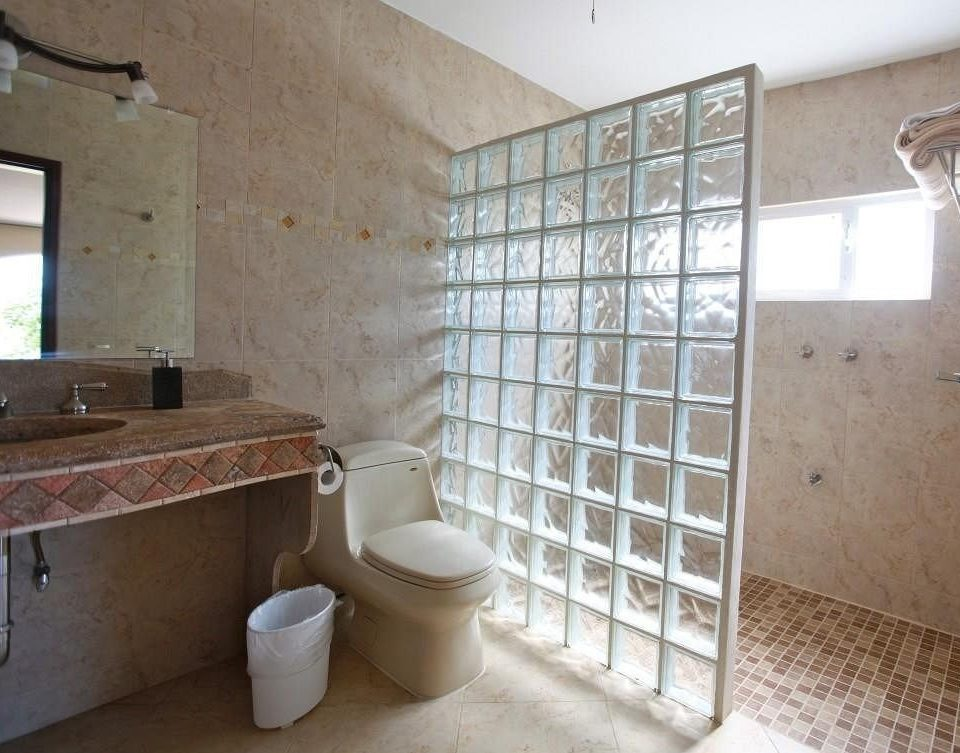 bathroom property house flooring home tile sink cottage loft tiled tub Bath bathtub
