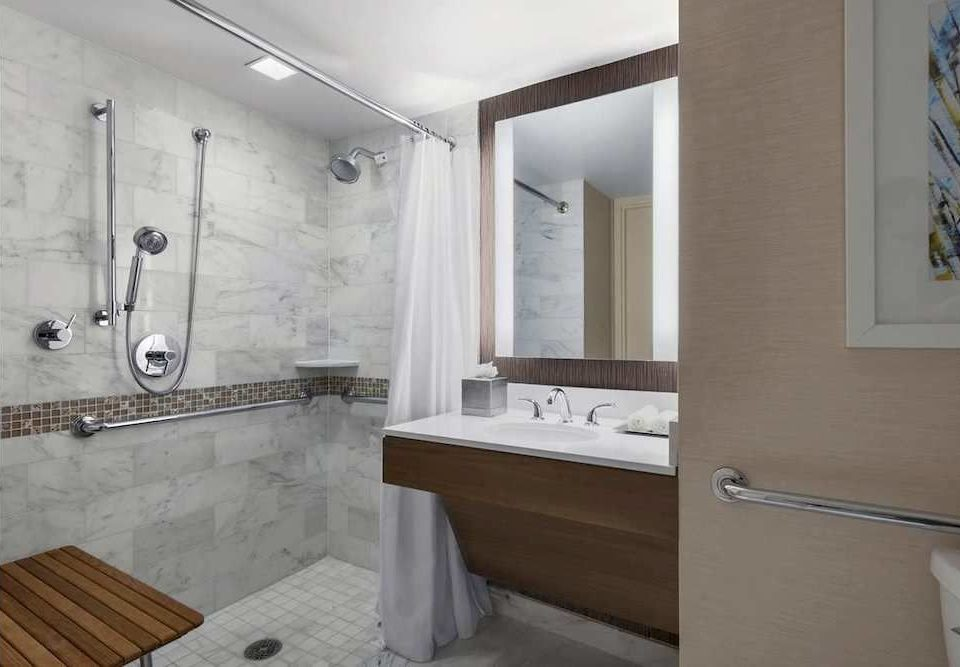 bathroom property home shower flooring cottage tub Bath bathtub tile