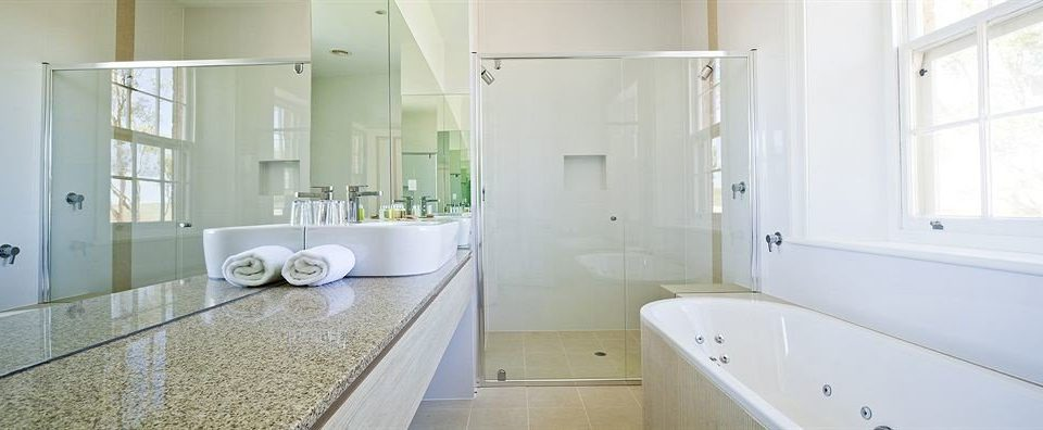 bathroom property mirror sink home flooring cottage plumbing fixture bathtub tub Bath tile tiled