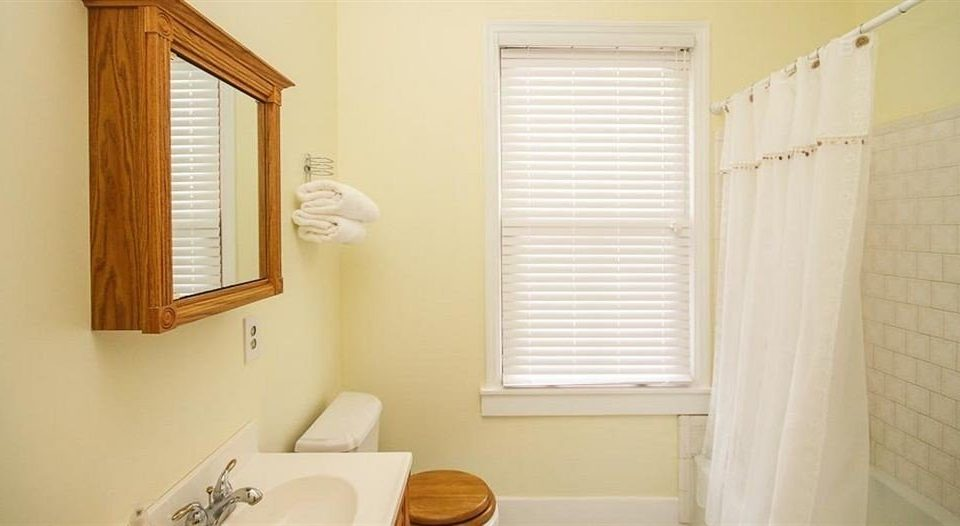 bathroom toilet property sink white home cottage curtain window treatment painted tub bathtub Bath tile tiled