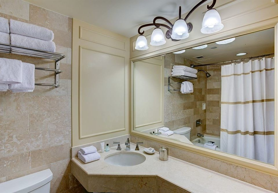 bathroom sink mirror property home toilet flooring tub cottage bathtub Bath tile tan