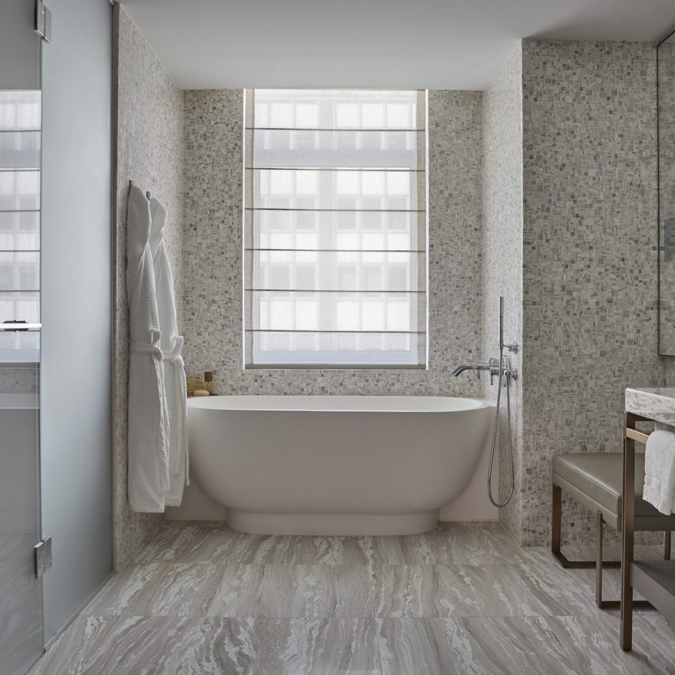 bathroom property tub home white flooring bathtub plumbing fixture tile cottage Bath tiled