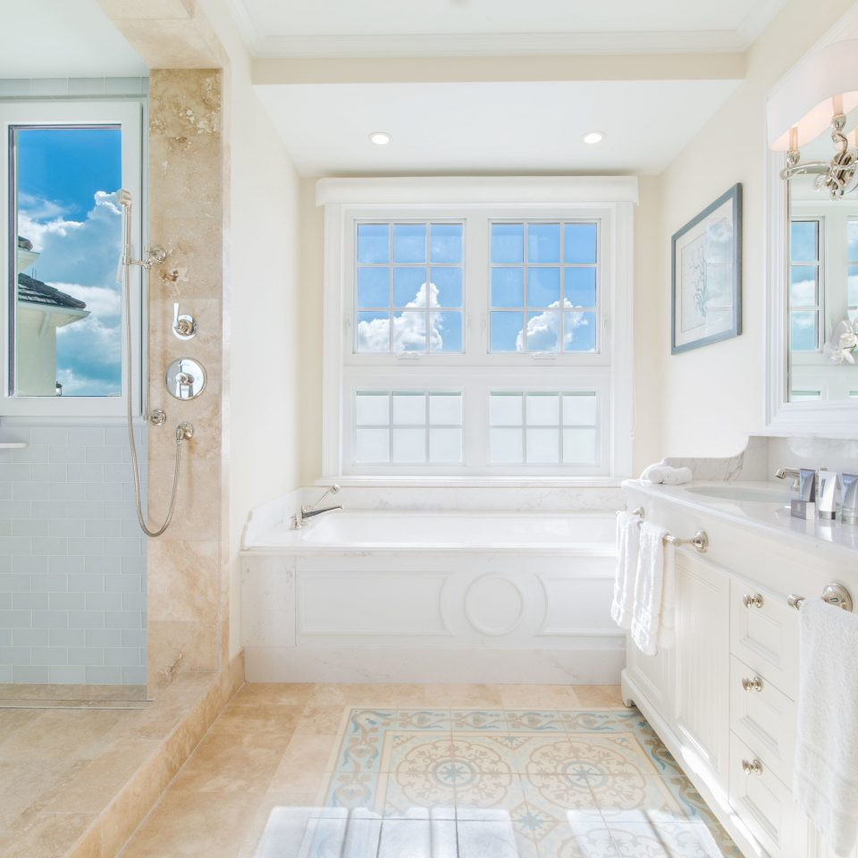 bathroom property home tub hardwood flooring sink cottage living room wood flooring farmhouse mansion laminate flooring bathtub tile Bath tiled
