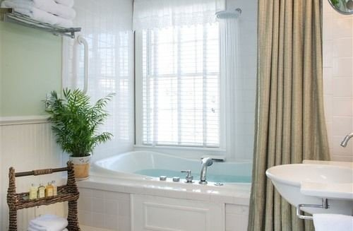 bathroom sink property tub vessel bathtub curtain window treatment cottage Bath tile tiled