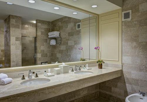 bathroom sink mirror property plumbing fixture tile flooring counter countertop bathtub toilet tub Bath