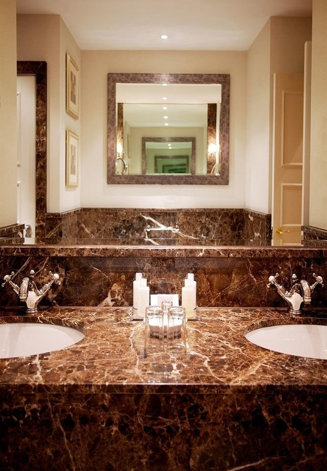 bathroom mirror sink vanity property double home towel counter living room mansion Bath tub countertop fancy tile stone bathtub round tiled