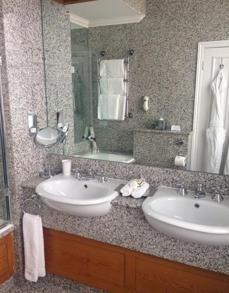 bathroom sink property countertop plumbing fixture flooring counter toilet tub tile tiled Bath bathtub