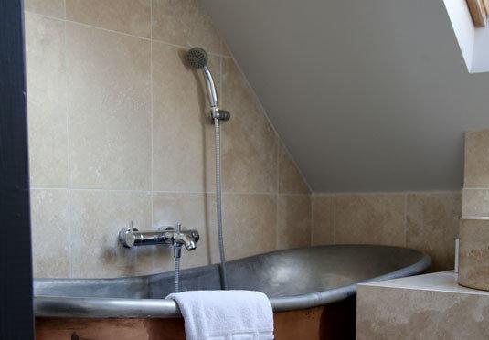 bathroom property plumbing fixture scene sink toilet tile flooring countertop bathtub tub tiled Bath