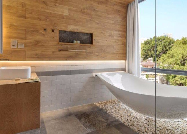 property swimming pool bathtub bathroom plumbing fixture countertop flooring tub jacuzzi Bath stone