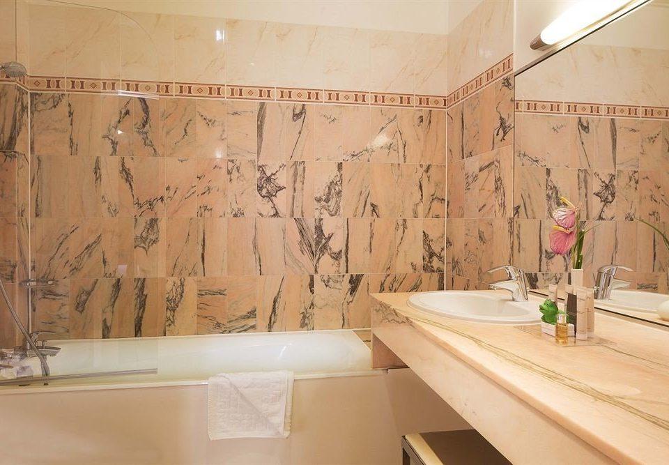 bathroom tub bathtub tile countertop sink flooring plumbing fixture material Bath