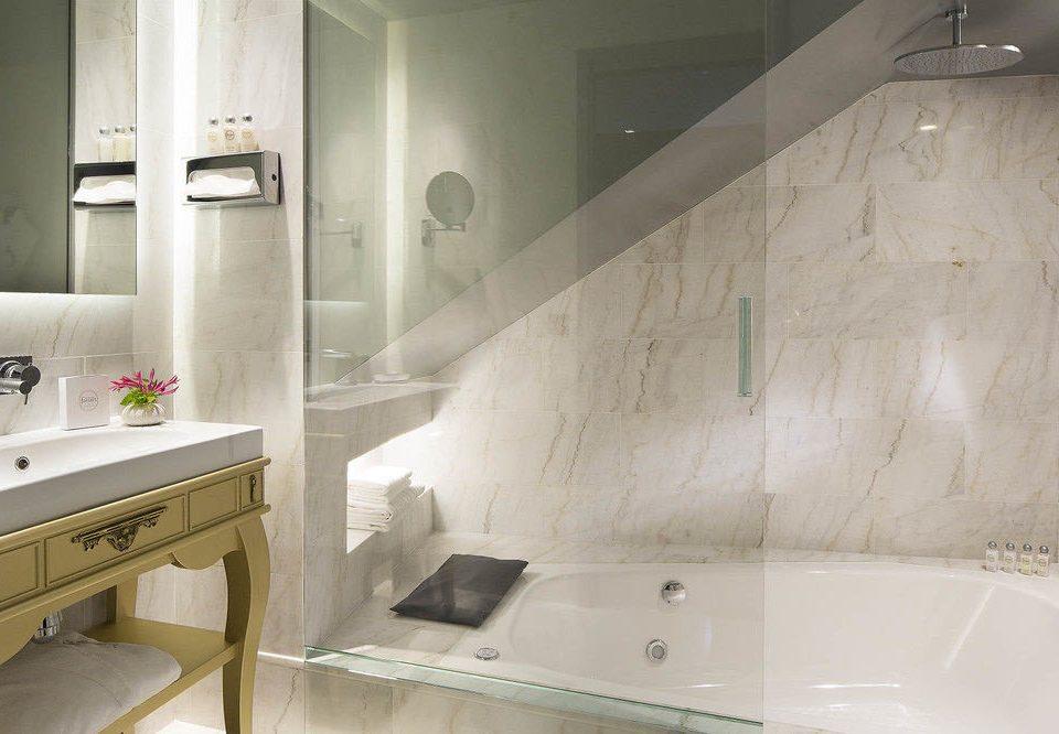 bathroom property countertop home sink plumbing fixture bathtub tile flooring tub Bath tiled