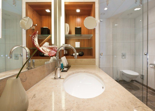 bathroom property sink countertop home plumbing fixture flooring toilet tub Bath bathtub