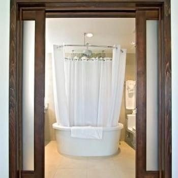 bathroom toilet plumbing fixture door curtain sink open tub bathtub Bath
