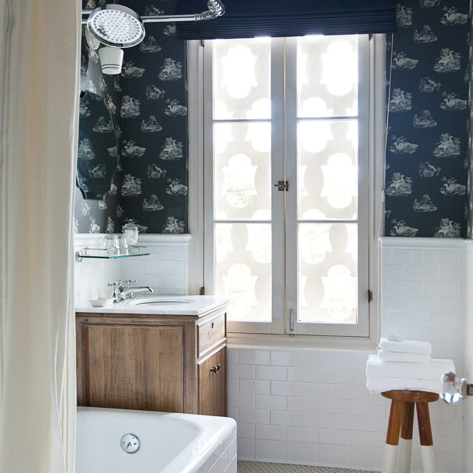 bathroom sink curtain door plumbing fixture window treatment textile sash window tub Bath bathtub tiled