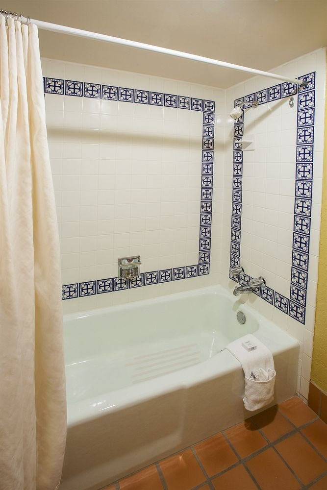bathroom plumbing fixture bathtub white curtain tiled tile Bath