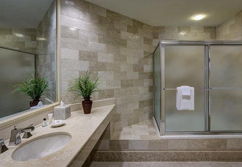 bathroom property sink toilet flooring home plumbing fixture tile daylighting bathtub Bath