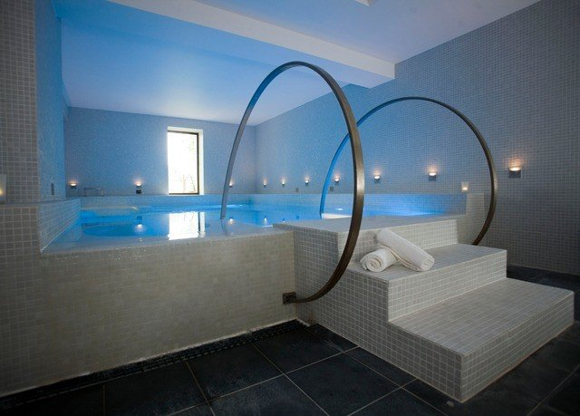 property swimming pool house bathroom bathtub daylighting jacuzzi tub tile tiled Bath